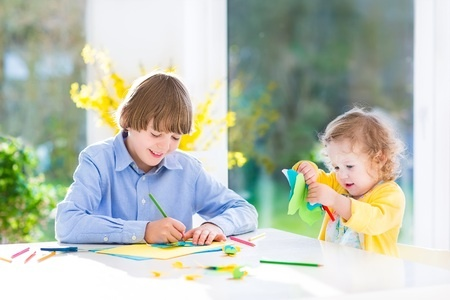 children using dining room table
